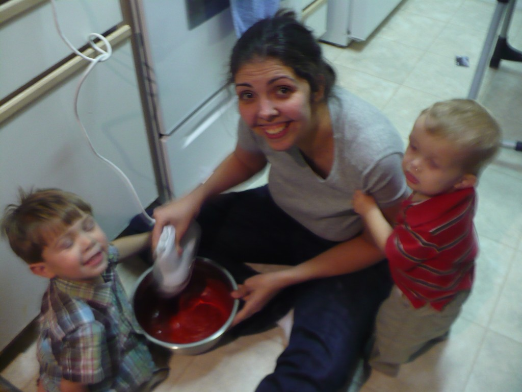 Mom and kids baking a cake