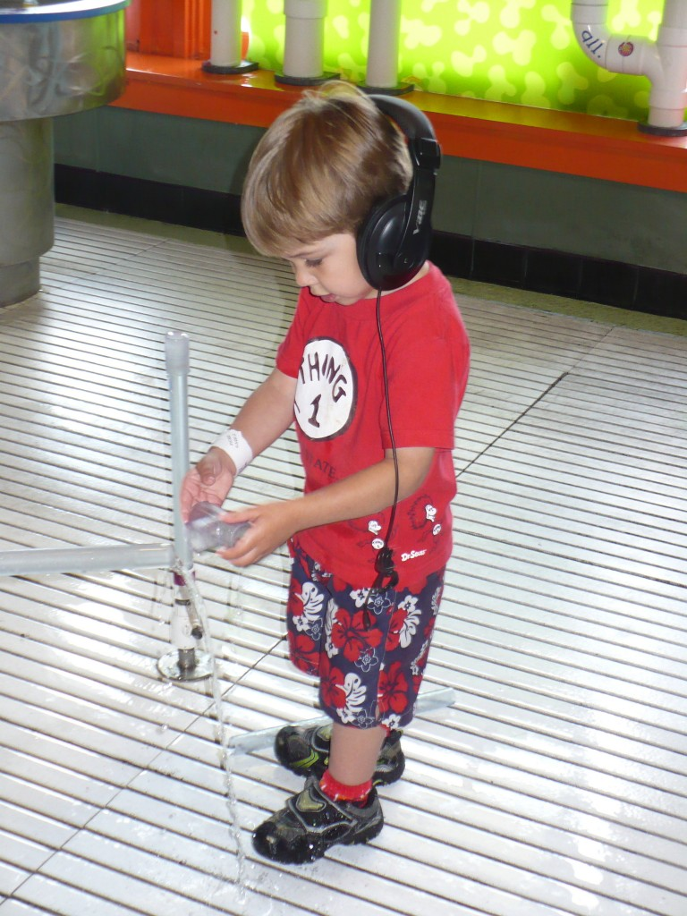 child with autism wearing headphones