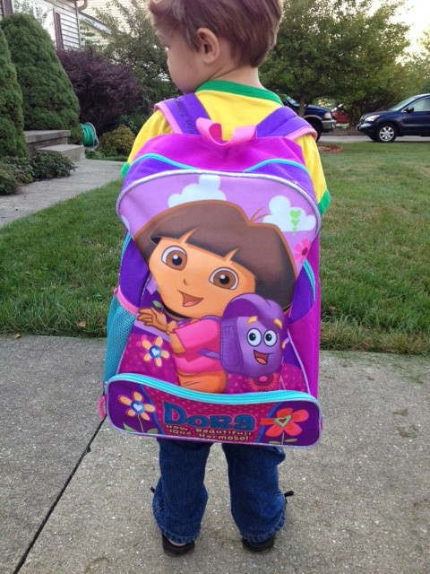 Preschooler with a Dora backpack