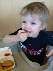 kid eating chicken nuggets