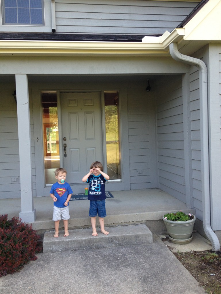 boys in front of house
